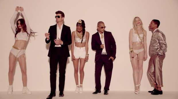 robin-thicke-pharrell-and-rapper-ti-dance-to-the-rhythm-of-the-blurred-lines-beat-with-models