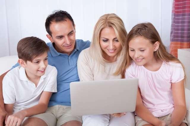 Happy Family Using Laptop